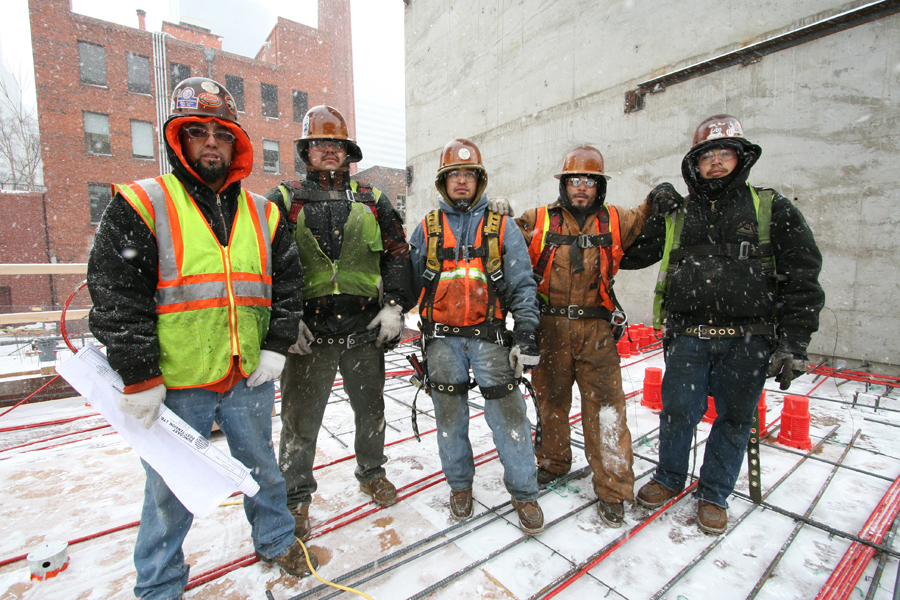 Structural workers getting ready to pour the first floor in a snow storm :  : Christopher Davies Photography