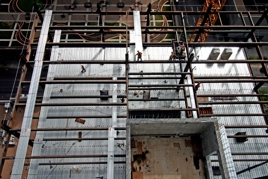 Aerial view of steel workers securing beams. :  : Christopher Davies Photography